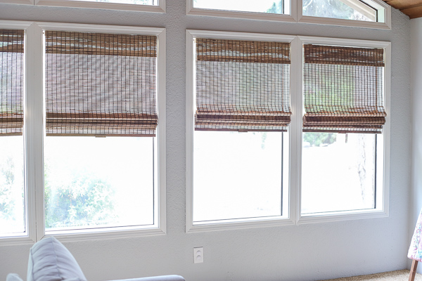 living room with painted trim and wood blinds