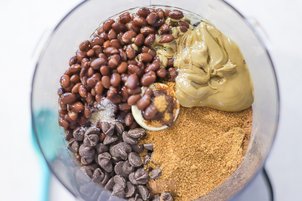ingredients to make chocolate hummus in a food processor