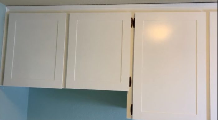 white shaker cabinet doors made from flat paneled doors are hung