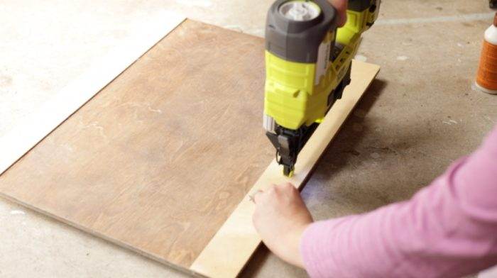 nailing trim using a brad nailer to a flat paneled cabinet door - how to make shaker cabinet doors