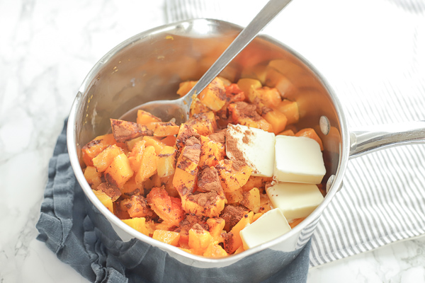 pot of butternut squash with butter, cinnamon, and  honey for mashed butternut squash