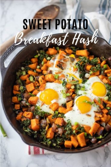 sweet potato breakfast hash in a cast iron skillet topped with eggs
