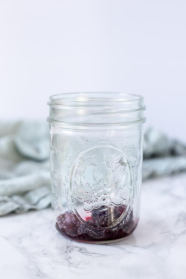 thawed blackberries in a mason jar