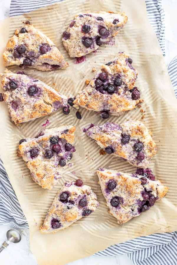 blueberry sourdough scones baked on parchment paper