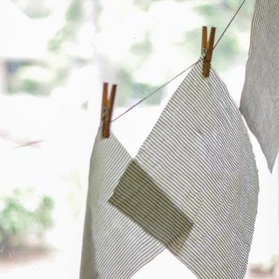 beeswax fabric hanging on twine with clothes hanger