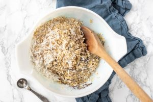 oats, chia seeds, and shredded coconut in a bowl to make coconut granola