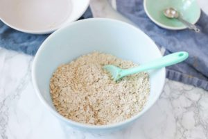 blueberry oatmeal cookie dry ingredients mixed into a antique bowl