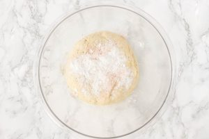 sourdough sweet roll dough with baking soda and baking powder sprinkled on top